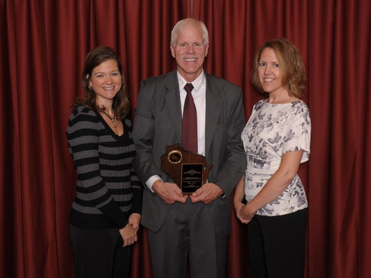 Jefferson Elementary School teachers Molly Johnson, left, and Renee Oestreich, right, accept the Wisconsin Title I School of Recognition award from Deputy State Superintendent Mike Thompson.