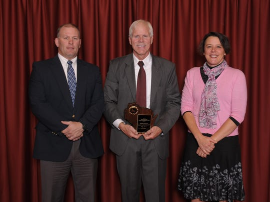 Principal Fritz Lehrke, from left, Deputy State Superintendent Michael Thompson and Weston Elementary teacher Theresa Sybeldon pose on Oct. 13 at the Capital Ceremony for Title I Schools of Recognition.