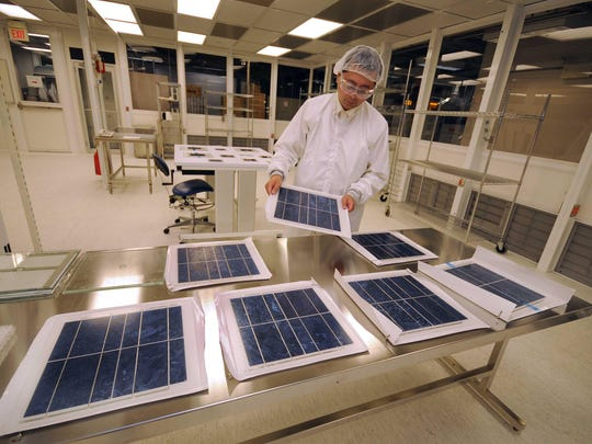 Chen Zhao works in the Photovoltaic Applications Lab at DuPont's Chestnut Run facility in 2010. Nelson Peltz, CEO of the activist asset management firm group Trian Partners, says institutional investors want his candidates on DuPont's board.