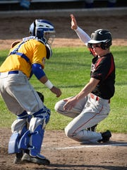 Pierz's Kolton Eischens, right, slides in past St. Cloud Cathedral catcher Zach Sufka to score during the fifth inning Thursday at Dick Putz Field in St. Cloud.