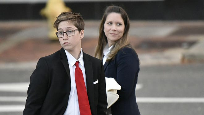 Drew Adams testified in December 2019 during the first day of his trial about bathroom rights for transgender students at Nease High School. He's pictured here leaving courthouse with his mother, Erica Adams Kasper.