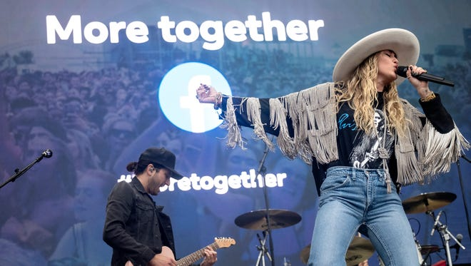 Miley Cyrus performs a live surprise set to celebrate the launch of Facebook's new campaign, More Together at the Beale Street Music Festival in Memphis.