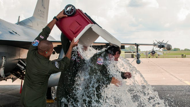 """U.S. Air Force Col. Clarence """"Ski"""" Borowski gets iced water dumped on him after his """"fini flight"""" on Aug. 7 on the flightline at Montgomery Regional Air National Guard Base."""