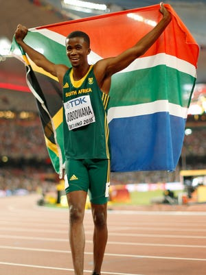 Anaso Jobodwana of South Africa celebrates after crossing the finish line to win bronze in the Men's 200 metres final during day six of the 15th IAAF World Athletics Championships Beijing 2015 at Beijing National Stadium on August 27, 2015 in Beijing, China.