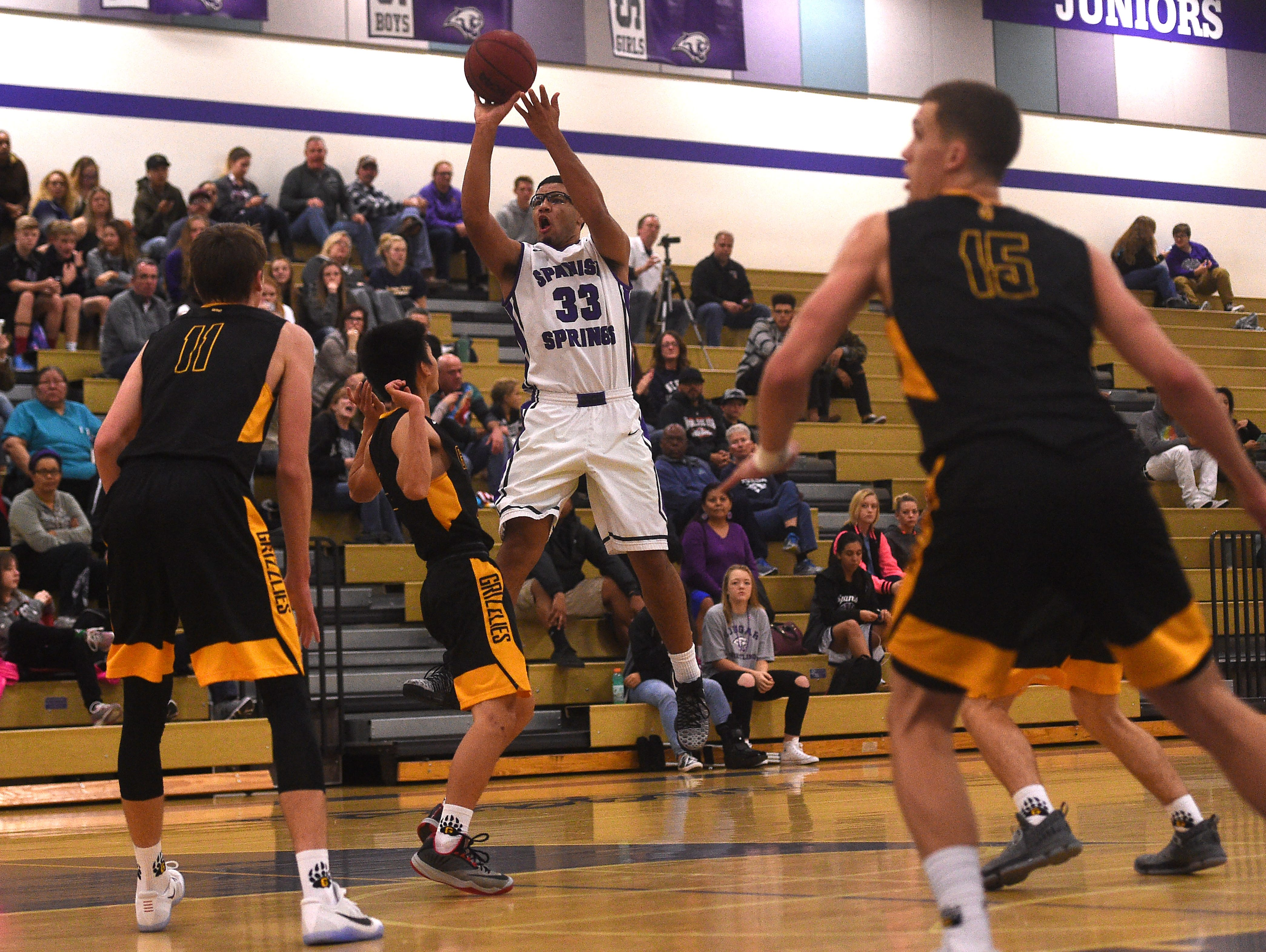 Spanish Springs' Marcus Loadholt (33) shoots while taking on Galena during their basketball game in Spanish Springs on Dec. 16. Dillon Voyles (15) is good friends with Loadholt.