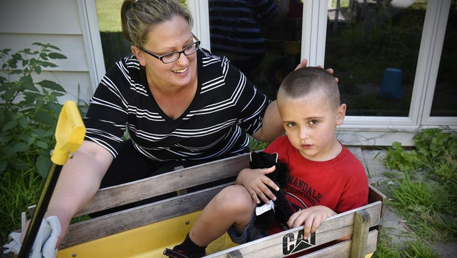 Kelly Korpela smiles at her son Trent on July 31 at their home near South Haven. Trent Korpela has been diagnosed with autism. Kelly Korpela recently enrolled in Partners in Policymaking, a state program, to learn how to be an advocate for her son and how to create change for him and others with disabilities.