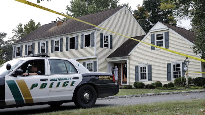 John Sheridan and his wife were victims of an intentionally set fire Sept. 28. Their four sons have hired a high-profile pathologist to help with the case.