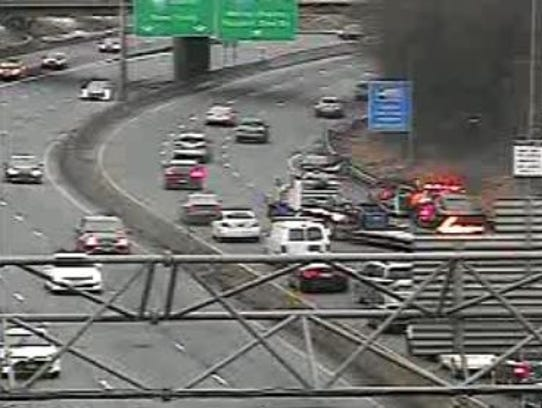 Drivers crawl past an accident on southbound Interstate