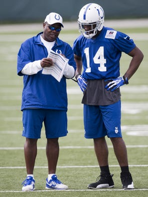 Charlie Williams (left), wide receivers coach, chats with Hakeem Nicks during Colts organized team activities at the Indiana Farm Bureau Football Center, Thursday, May 29, 2014.