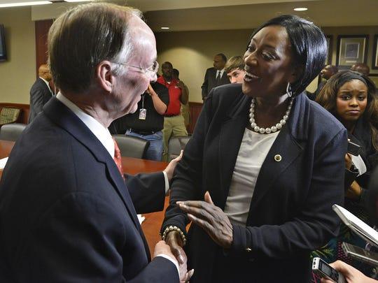 Gov. Robert Bentley, greets Gwendolyn Boyd after the ASU Board of Trustees  meeting in 2013.
