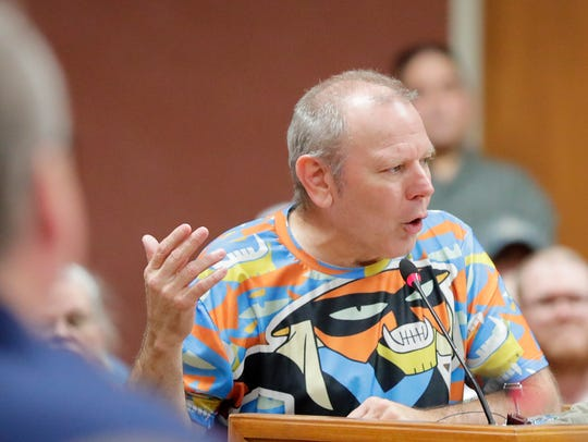 Green Bay Alderman Randy Scannell speaks on July 18 in favor of putting a question about the legality of marijuana on the November ballot. Scannell and members of the public spoke at a Brown County Board meeting at City Hall in Green Bay.