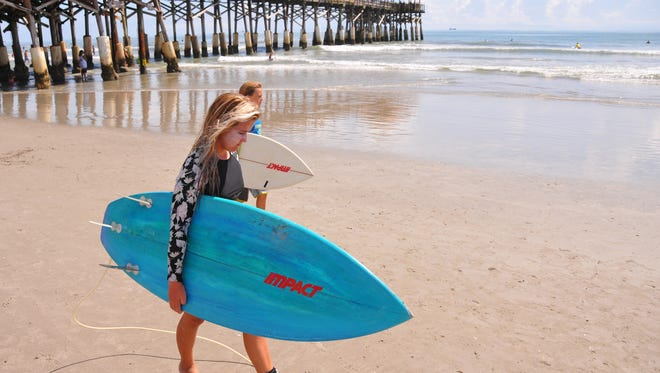 Big crowds and small waves showed up for the 32nd annual NKF Rich Salick Pro-Am Surf Festival at the Cocoa Beach Pier on Saturday.