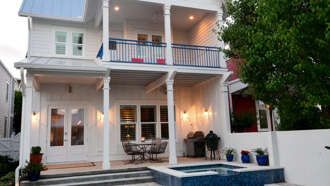 The coastal themed residence overlooks the courtyard, where the spa and pool are a fabulous centerpiece.