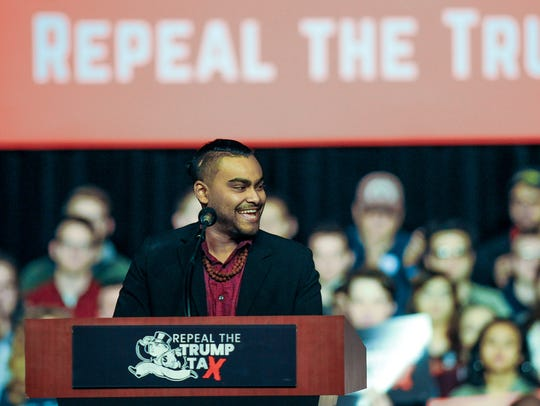Omar Karim, a Michigan State University student and Lansing Community College graduate, addressed the crowd at Sunday's rally.