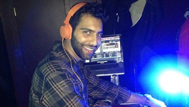 Alykhan Alani, founder of DoingGoodROC, DJs at one of his events.