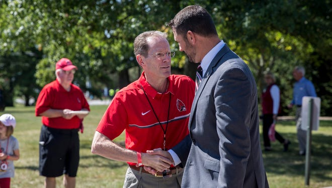 Ball State president Geoffrey Mearns shakes football coach Mike Neu's hands before the first home game Sept. 9 against UAB.