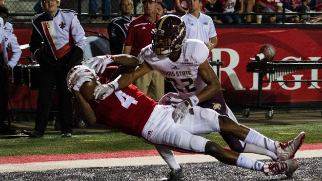 UL Ragin' Cajuns wide receiver Jamal Robinson (4) pulls in a pass to score a touchdown during the first half of an NCAA football game against the Texas State Bobcats at Cajun Field in Lafayette, La., Saturday, Oct. 10, 2015.