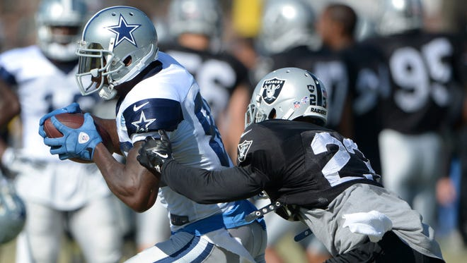 Dallas Cowboys receiver Dez Bryant (88) is defended by Oakland Raiders cornerback Tarell Brown (23) at scrimmage against the Oakland Raiders at River Ridge Fields.