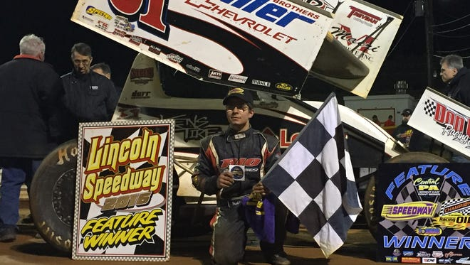 Freddie Rahmer poses in victory lane after winning the 410 sprint feature Saturday night at Lincoln Speedway. Rahmer went from fourth to first in one lap to earn the victory.