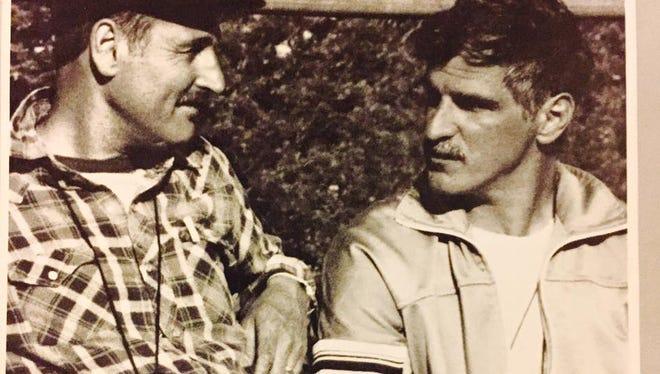Asbury Park H.S. track coach Tony Giordano with Bryan Spoonire