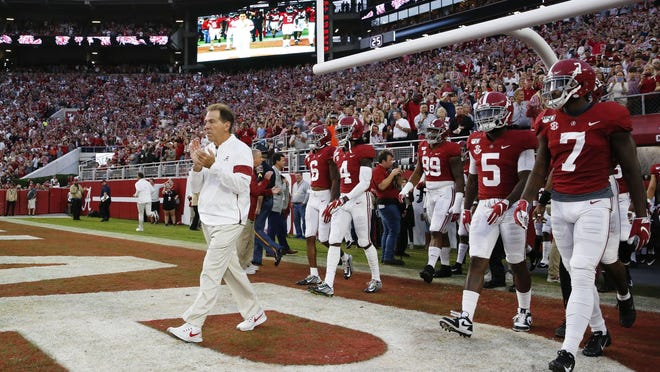 Coach Nick Saban leads the Crimson Tide onto the field before Alabama's homecoming game against Arkansas in Bryant-Denny Stadium on Oct. 26, 2019.