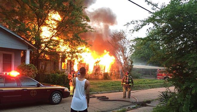 Jackson firefighters battled a blaze at an abandoned house on Blair Street near downtown Thursday morning.