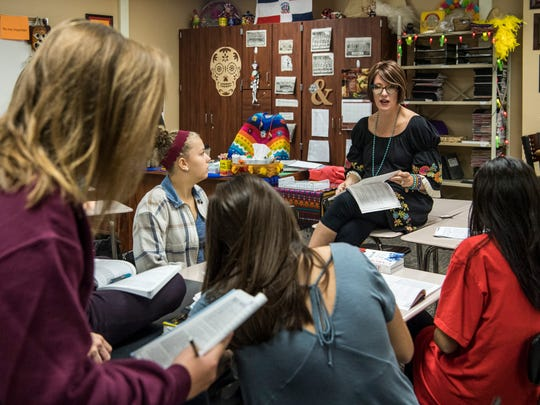 Spanish teacher J.J. Epperson (back right) talks with students in her third period Level Four Spanish class at Gibson Southern High School in Fort Branch, Ind., Tuesday, Oct. 10, 2017.