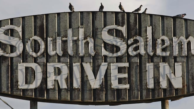 The sign from the South Salem Drive-In was still up in August 2013 after closing in 1993. The site continues to entertain moviegoers as the home of the Santiam 11 movie theater.