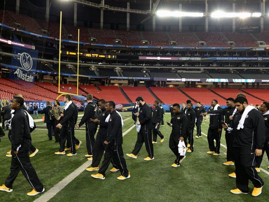 Members of the Missouri Tigers football team hold a delayed walk through during practice at the Georgia Dome. Missouri plays the Alabama Crimson Tide in the SEC Championship on Saturday.
