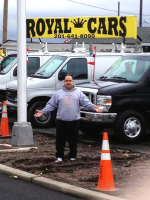 Rudy Perez, co-owner of Royal Cars, is upset that road improvements to Route 46 in Little Ferry have left his business with restricted access to the highway and lots of mud.