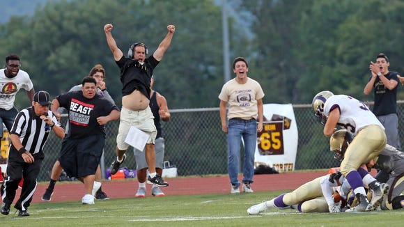 Clarkstown North's side line celebrates when Rhys Farrell-Bryan (7) intercepts the ball from Clarkstown South's Kyle Samuels (4) during game action at Clarkstown South High School in West Nyack Sept. 4, 2015.