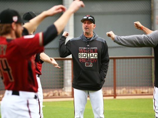 Torey Lovullo talks with pitcher Andrew Chafin during the first day of spring training last week.