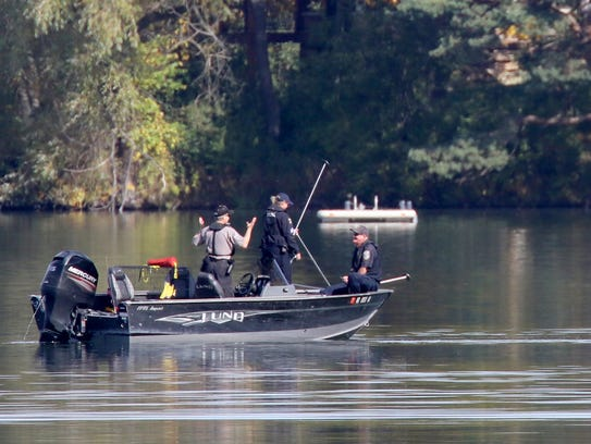 A boat with local police head out onto Upper Nashotah