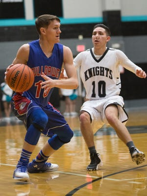 Las Cruces High's Cayden Sherwood, left. drives down court as Oñate's Antonio Zamora, right, guards him, during the boys district championship game at Oñate High School on Saturday.