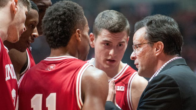 Indiana coach Tom Crean gathers his players during a timeout during the second half of an NCAA college basketball game against Illinois in Champaign, Ill., on Thursday, Feb. 25, 2016. Indiana defeated Illinois 74-47. (AP Photo/Heather Coit)