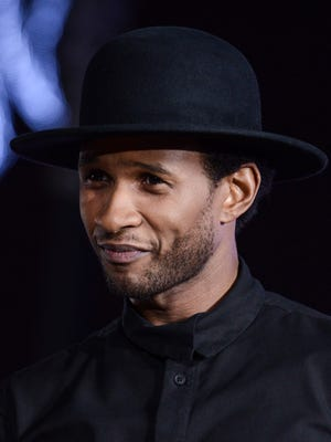 Usher arrives at the premiere of 'Justin Bieber's Believe' on Dec. 18, 2013, in Los Angeles.