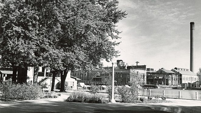 This photograph of the Neenah Paper Company was taken from Shattuck Park around 1930. The old pavilion is visible on the left. Neenah Paper Company, located on North Commercial Street, was organized in 1866. In 1956 it became a division of Kimberly-Clark. In 2004 Neenah Paper Inc. became independent of the Kimberly-Clark Corp.