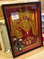 A framed Hickory uniform is shown on display.