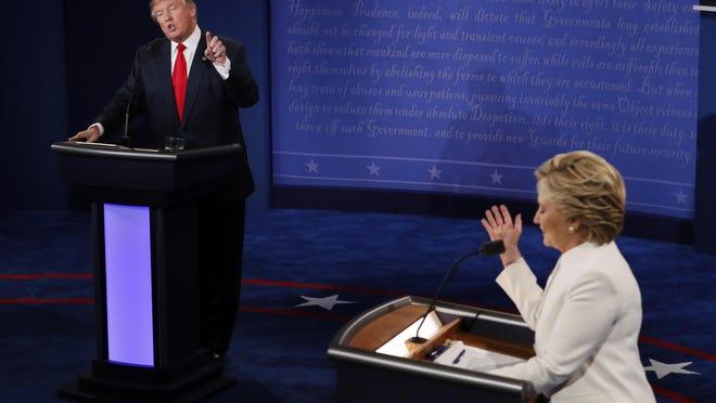 Democratic presidential nominee Hillary Clinton debates with Republican presidential nominee Donald Trump during the final presidential debate at UNLV in Las Vegas.