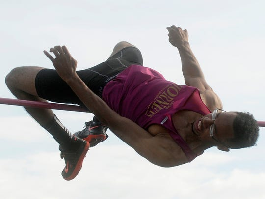 Licking Heights' Curtis Richardson breaks the meet record clearing 6-10.5 during the Regional Championships in May.