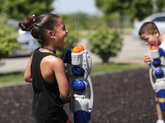 It was hot enough Monday that Sophia Ceppieri, 5, of Hasbrouck Heights and Gianfranco Olivieri, 6, of Paterson, sprayed themselves with water guns.