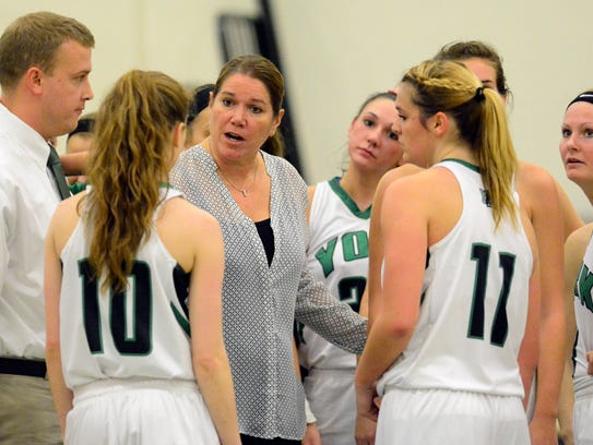 Coach Betsy Witman, center, believes her current York