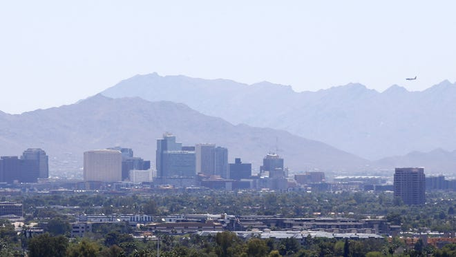 Haze covers the downtown Phoenix skyline on May 4, 2017. Officials have continued the ozone high pollution advisory that has been in effect since May 2, 2017.