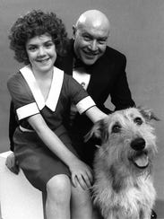 "Actor Reid Shelton is shown in costume as Oliver ""Daddy"" Warbucks with Andrea McArdle as ""Annie"" on Feb. 24, 1977."