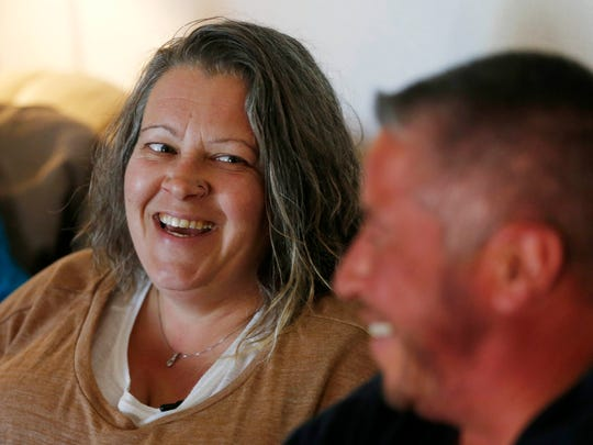 Tammi DeLathower, left, looks on and smiles as husband, Aiden, talks about how the couple met Sunday, Nov. 6, 2016, at their home in Davenport.