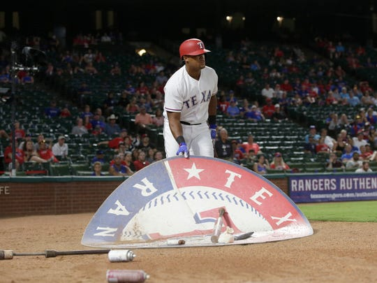 Texas Rangers third baseman Adrian Beltre moves the on deck circle in the eighth inning against the Miami Marlins.