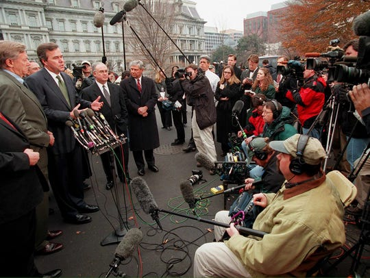 Then-governor Jeb Bush speaks to reporters on Dec.