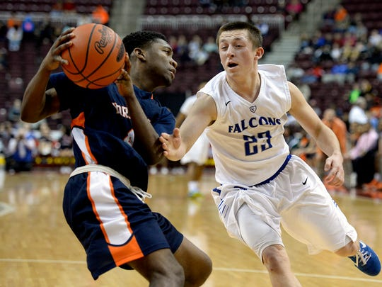 Cedar Crest's Dominic Garloff attempts a steal late in the Falcons' 56-53 loss to York in the 2015 District 3 AAAA boys basketball final on February 28, 2015.