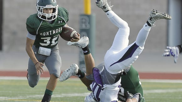 Montwood running back Evan De Anda takes off out of the backfield behind a great block against Franklin Friday.