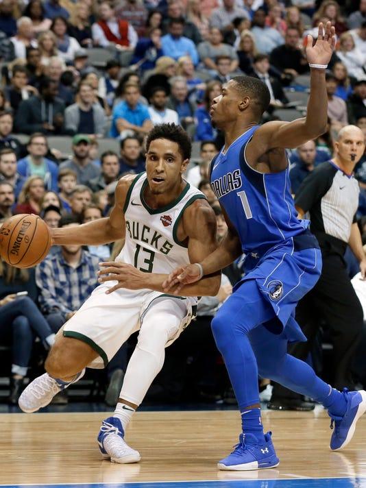 Milwaukee Bucks guard Malcolm Brogdon (13) moves to the basket as Dallas Mavericks' Dennis Smith Jr. (1) defends in the first half of an NBA basketball game, Saturday, Nov. 18, 2017, in Dallas. (AP Photo/Tony Gutierrez)